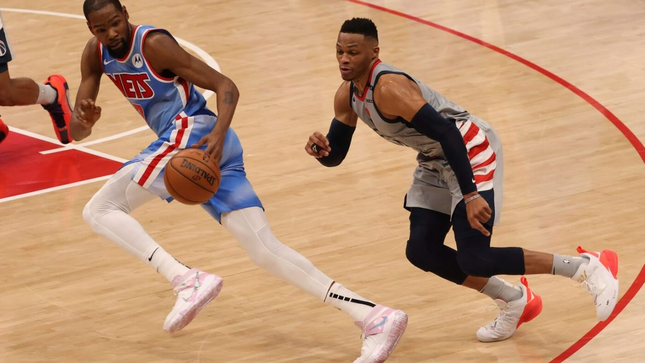 Jan 31, 2021; Washington, District of Columbia, USA; Washington Wizards guard Russell Westbrook (4) attempts to steal the ball from Brooklyn Nets forward Kevin Durant (7) in the final seconds in the fourth quarter at Capital One Arena. Mandatory Credit: Geoff Burke-USA TODAY Sports