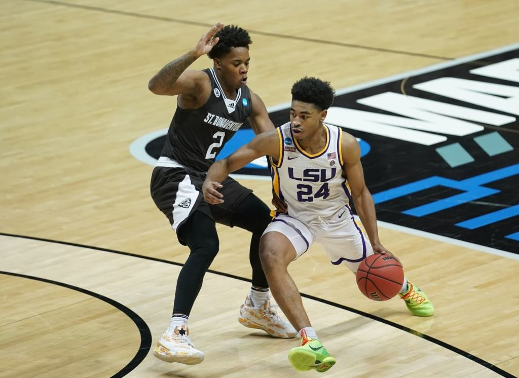 Mar 20, 2021; Bloomington, Indiana, USA; Louisiana State Tigers guard Cameron Thomas (24) moves the ball against St. Bonaventure Bonnies guard Eddie Creal (2) during the second half in the first round of the 2021 NCAA Tournament at Simon Skjodt Assembly Hall. Mandatory Credit: Robert Goddin-USA