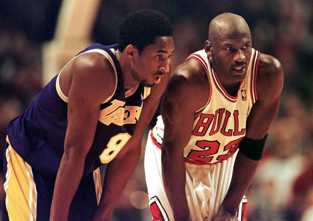 Los Angeles Lakers guard Kobe Bryant(L) and Chicago Bulls guard Michael Jordan(R) talk during a free-throw attempt during the fourth quarter 17 December at the United Center in Chicago. Bryant, who is 19 and bypassed college basketball to play in the NBA, scored a team-high 33 points off the bench, and Jordan scored a team-high 36 points. The Bulls defeated the Lakers 104-83. AFP PHOTO VINCENT LAFORET (Photo by VINCENT LAFORET / AFP) (Photo credit should read VINCENT LAFORET/AFP/Getty Images)