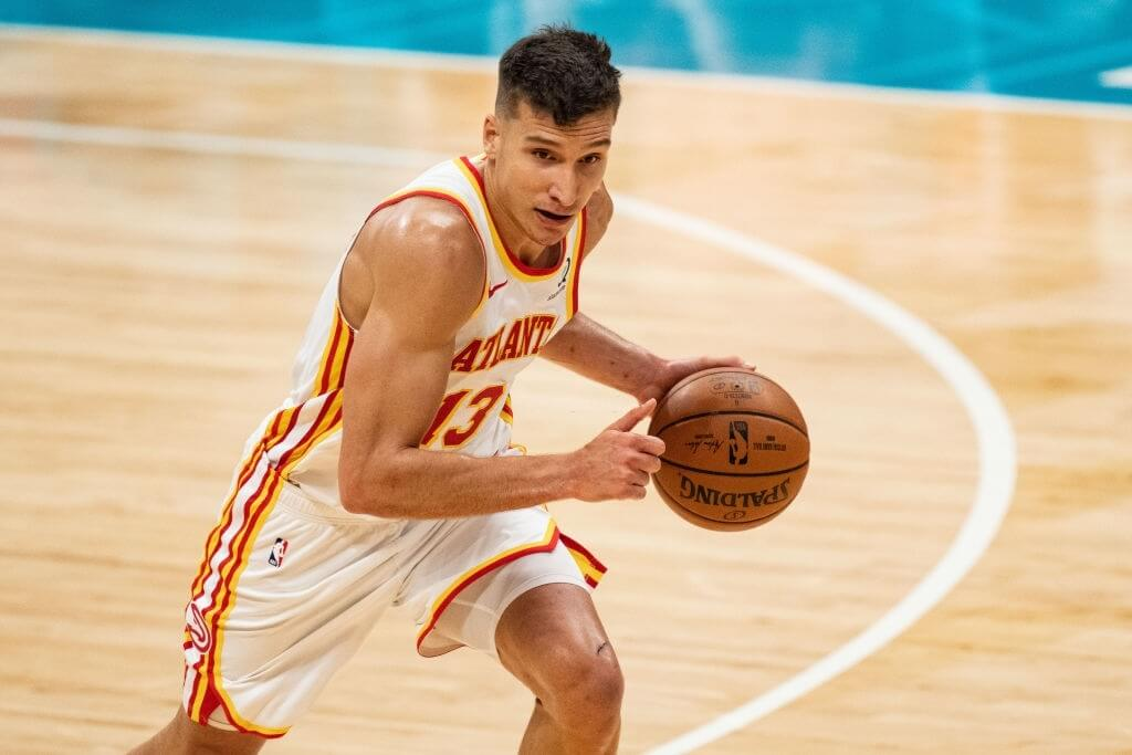 CHARLOTTE, NORTH CAROLINA - APRIL 11: Bogdan Bogdanovic #13 of the Atlanta Hawks brings the ball up court against the Charlotte Hornets in the first half during their game at Spectrum Center on April 11, 2021 in Charlotte, North Carolina. NOTE TO USER: User expressly acknowledges and agrees that, by downloading and or using this photograph, User is consenting to the terms and conditions of the Getty Images License Agreement. (Photo by Jacob Kupferman/Getty Images)