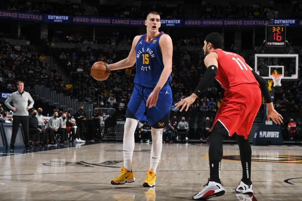 DENVER, CO - MAY 22: Enes Kanter #11 of the Portland Trail Blazers plays defense on Nikola Jokic #15 of the Denver Nuggets during Round 1, Game 1 of the the 2021 NBA Playoffs on May 22, 2021 at the Ball Arena in Denver, Colorado. NOTE TO USER: User expressly acknowledges and agrees that, by downloading and/or using this Photograph, user is consenting to the terms and conditions of the Getty Images License Agreement. Mandatory Copyright Notice: Copyright 2021 NBAE (Photo by Garrett Ellwood/NBAE via Getty Images)