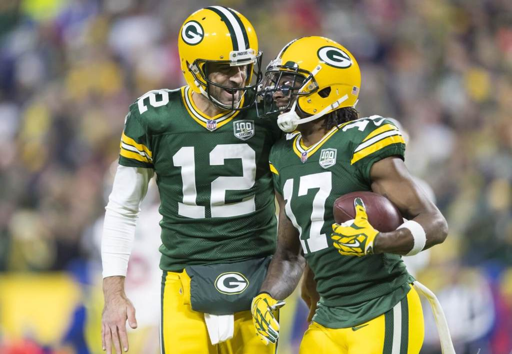 Oct 15, 2018; Green Bay, WI, USA; Green Bay Packers quarterback Aaron Rodgers (12) celebrates with wide receiver Davante Adams (17) following a touchdown during the first quarter against the San Francisco 49ers at Lambeau Field. Mandatory Credit: Jeff Hanisch-USA TODAY Sports