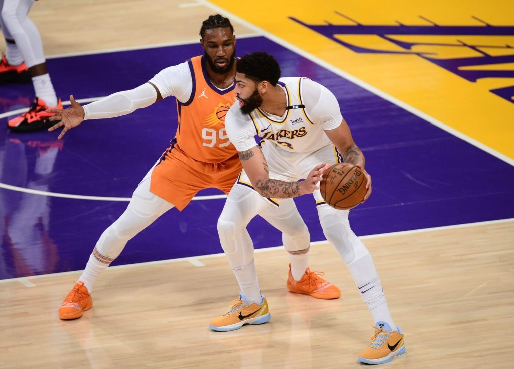 May 30, 2021; Los Angeles, California, USA; Los Angeles Lakers forward Anthony Davis (3) controls the ball against Phoenix Suns forward Jae Crowder (99) during the first half in game four of the first round of the 2021 NBA Playoffs. at Staples Center. Mandatory Credit: Gary A. Vasquez-USA TODAY Sports
