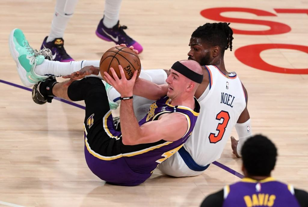 May 11, 2021; Los Angeles, California, USA; Los Angeles Lakers guard Alex Caruso (4) and New York Knicks center Nerlens Noel (3) scramble for a loose ball in the first quarter of the game at Staples Center. Mandatory Credit: Jayne Kamin-Oncea-USA TODAY Sports