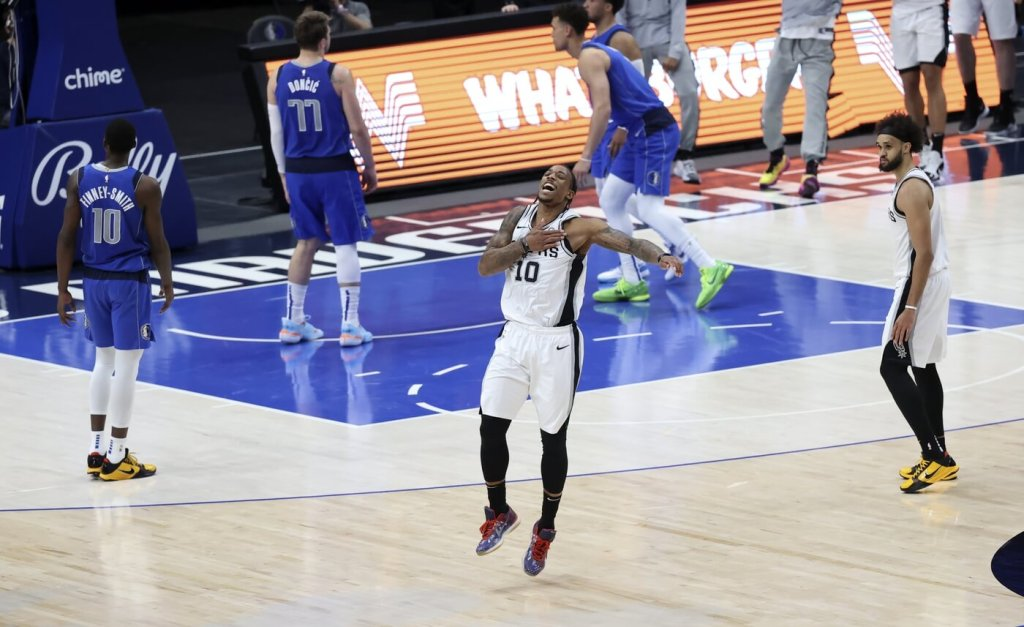 Apr 11, 2021; Dallas, Texas, USA; San Antonio Spurs forward DeMar DeRozan (10) reacts after hitting the game-winning clutch shot against the Dallas Mavericks during the fourth quarter at American Airlines Center. Mandatory Credit: Kevin Jairaj-USA TODAY Sports