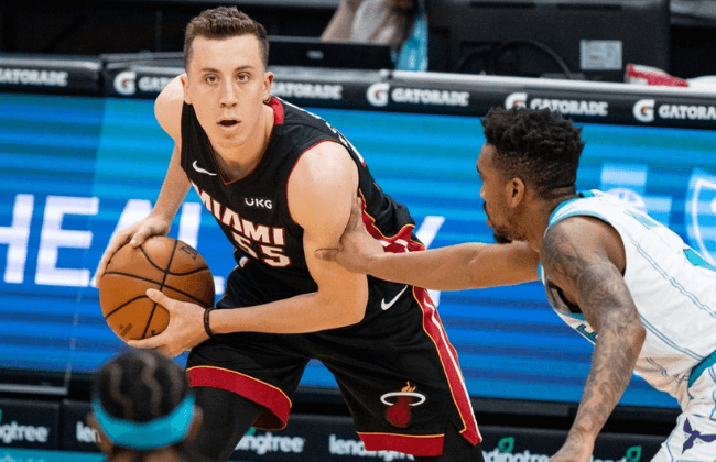 CHARLOTTE, NORTH CAROLINA - MAY 02: Duncan Robinson #55 of the Miami Heat controls the ball against Malik Monk #1 of the Charlotte Hornets in the second quarter at Spectrum Center on May 02, 2021 in Charlotte, North Carolina. NOTE TO USER: User expressly acknowledges and agrees that, by downloading and or using this photograph, User is consenting to the terms and conditions of the Getty Images License Agreement. (Photo by Jacob Kupferman/Getty Images)