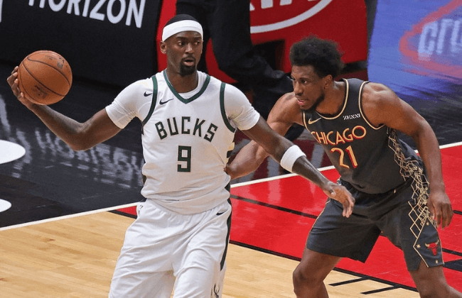 CHICAGO, ILLINOIS - APRIL 30: Bobby Portis #9 of the Milwaukee Bucks readies to move against Thaddeus Young #21 of the Chicago Bulls at the United Center on April 30, 2021 in Chicago, Illinois. The Bucks defeated the Bulls 108-98. NOTE TO USER: User expressly acknowledges and agrees that, by downloading and or using this photograph, User is consenting to the terms and conditions of the Getty Images License Agreement. (Photo by Jonathan Daniel/Getty Images)