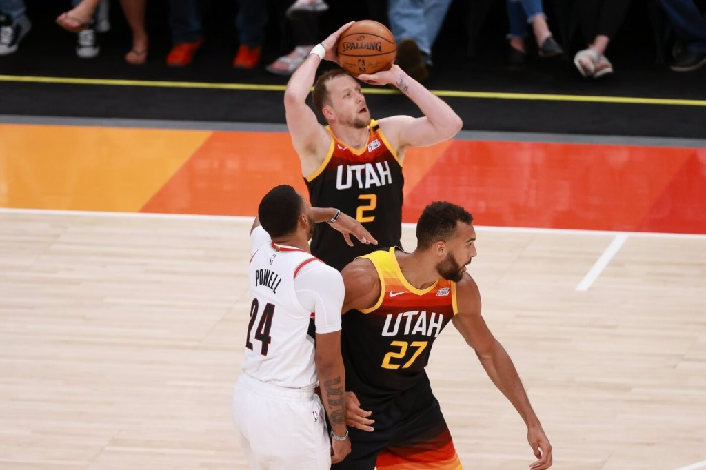 May 12, 2021; Salt Lake City, Utah, USA; Utah Jazz center Rudy Gobert (27) blocks Portland Trail Blazers forward Norman Powell (24) so guard Joe Ingles (2) can shoot the ball during the second quarter at Vivint Arena. Mandatory Credit: Chris Nicoll-USA TODAY Sports