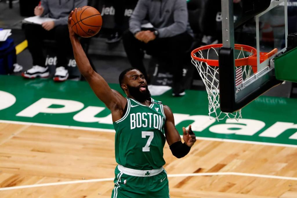 Apr 7, 2021; Boston, Massachusetts, USA; Boston Celtics guard Jaylen Brown (7) goes in for a dunk during the fourth quarter against the New York Knicks at TD Garden. Mandatory Credit: Winslow Townson-USA TODAY Sports