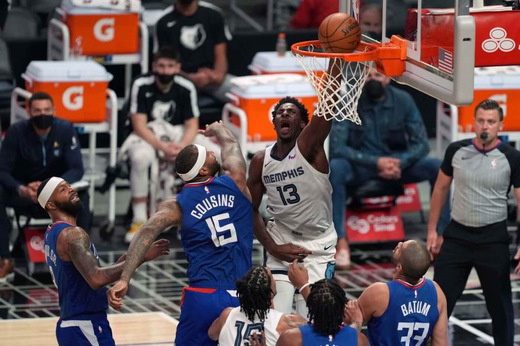 Apr 21, 2021; Los Angeles, California, USA; Memphis Grizzlies forward Jaren Jackson Jr. (13) dunks the ball over LA Clippers center DeMarcus Cousins (15) in the second half at Staples Center. Mandatory Credit: Kirby Lee-USA TODAY Sports