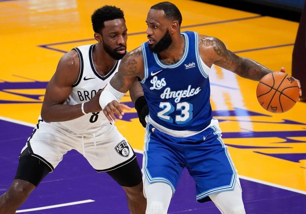 Feb 18, 2021; Los Angeles, California, USA; Los Angeles Lakers forward LeBron James (23) defended b y Brooklyn Nets forward Jeff Green (8) during the third quarter at Staples Center. Mandatory Credit: Robert Hanashiro-USA TODAY Sports
