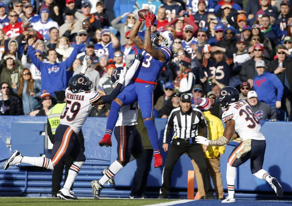 Nov 4, 2018; Orchard Park, NY, USA; Buffalo Bills wide receiver Kelvin Benjamin (13) jumps to catch the ball while being defended by Chicago Bears inside linebacker Danny Trevathan (59) and strong safety Adrian Amos (38) during the second half at New Era Field. Mandatory Credit: Timothy T. Ludwig-USA TODAY Sports