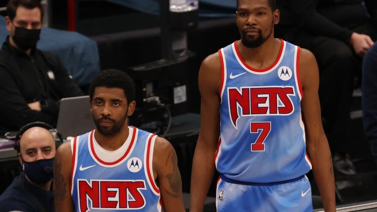 Jan 31, 2021; Washington, District of Columbia, USA; Brooklyn Nets guard Kyrie Irving (11) and Nets forward Kevin Durant (7) stand at the scorer's table against the Washington Wizards at Capital One Arena. Mandatory Credit: Geoff Burke-USA TODAY Sports