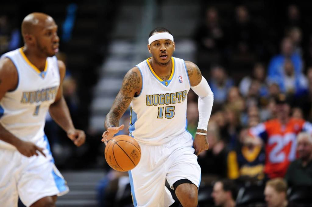 Feb 7, 2011; Denver, CO, USA; Denver Nuggets small forward Carmelo Anthony (15) brings the basketball up court in the first quarter against the Houston Rockets at the Pepsi Center. Mandatory Credit: Ron Chenoy-USA TODAY Sports