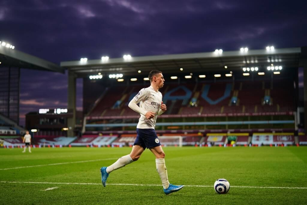 BIRMINGHAM, ENGLAND - APRIL 21: Phil Foden of Manchester City prepares to take a corner during the Premier League match between Aston Villa and Manchester City at Villa Park on April 21, 2021 in Birmingham, England. Sporting stadiums around the UK remain under strict restrictions due to the Coronavirus Pandemic as Government social distancing laws prohibit fans inside venues resulting in games being played behind closed doors.