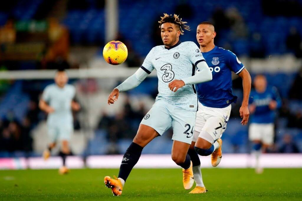 Chelsea's English defender Reece James (C) vies for the ball against Everton's Brazilian striker Richarlison (R) during the English Premier League football match between Everton and Chelsea at Goodison Park in Liverpool, north west England on December 12, 2020.