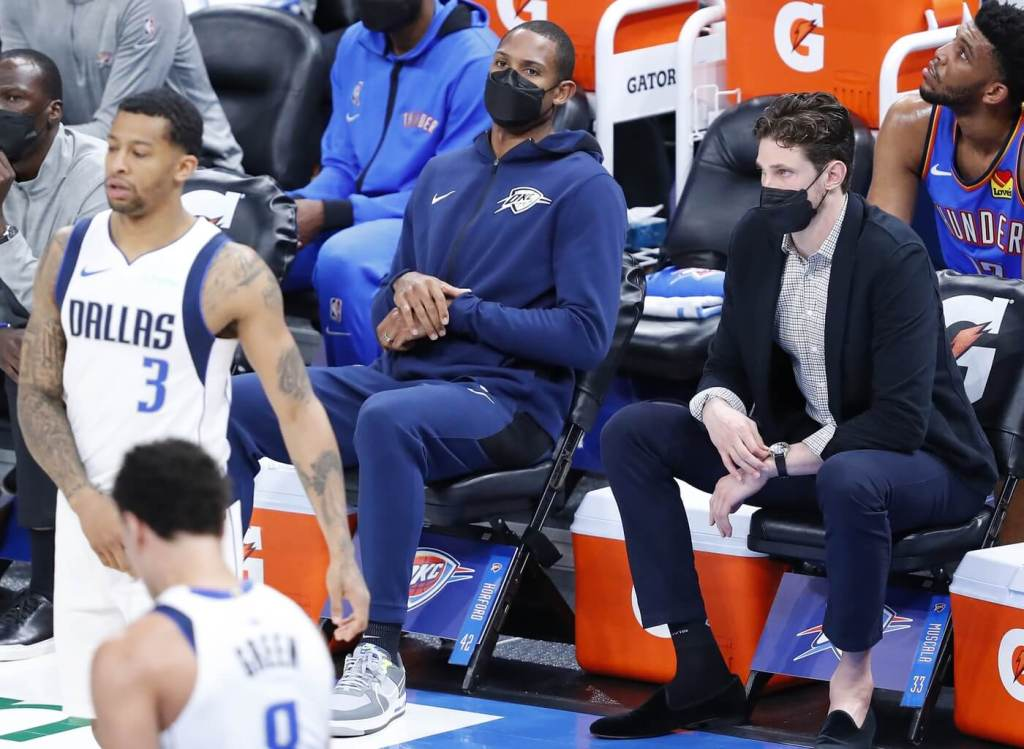 Mar 29, 2021; Oklahoma City, Oklahoma, USA; Oklahoma City Thunder center Al Horford (left) and center Mike Muscala (right) watch a game against the Dallas Mavericks from the bench during the second half at Chesapeake Energy Arena. Dallas won 127-106. Mandatory Credit: Alonzo Adams-USA TODAY Sports