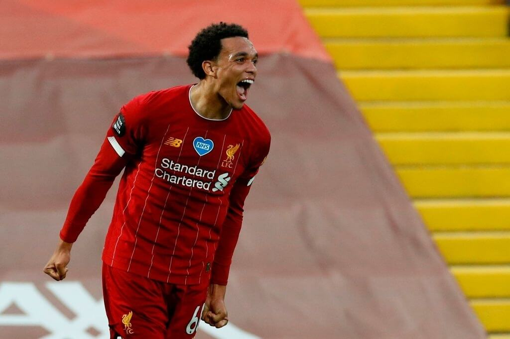 Liverpool's English defender Trent Alexander-Arnold celebrates scoring their second goal during the English Premier League football match between Liverpool and Chelsea at Anfield in Liverpool, north west England on July 22, 2020.