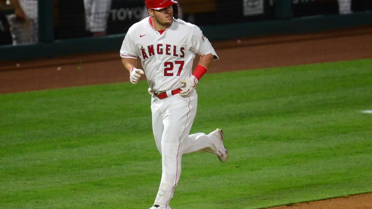 May 4, 2021; Anaheim, California, USA; Los Angeles Angels center fielder Mike Trout (27) rounds the bases after hitting a solo home run against the Tampa Bay Rays during the sixth inning at Angel Stadium. Mandatory Credit: Gary A. Vasquez-USA TODAY Sports