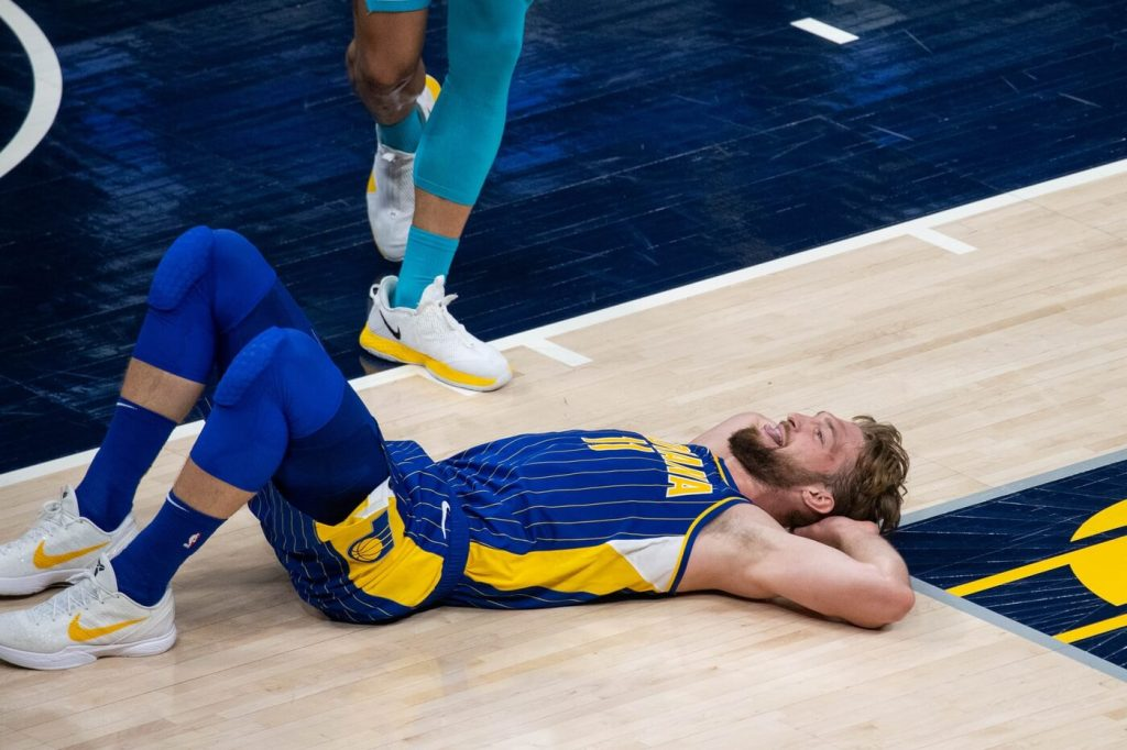 May 18, 2021; Indianapolis, Indiana, USA; Indiana Pacers forward Domantas Sabonis (11) smiles while laying on the court after he is blocked in the second quarter against the Charlotte Hornets at Bankers Life Fieldhouse. Mandatory Credit: Trevor Ruszkowski-USA TODAY Sports