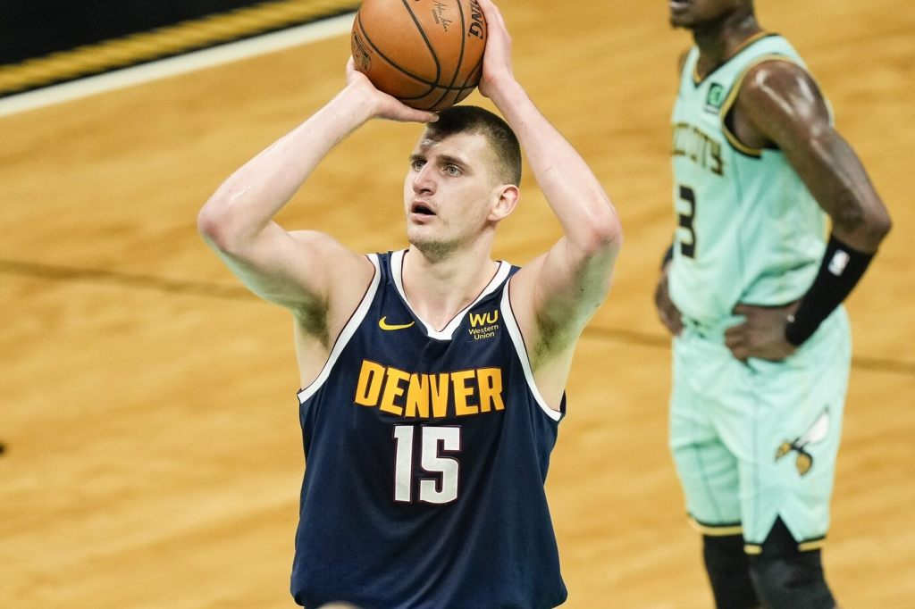 May 11, 2021; Charlotte, North Carolina, USA; Denver Nuggets center Nikola Jokic (15) takes a free throw against the Charlotte Hornets during the second quarter at the Spectrum Center. Mandatory Credit: Jim Dedmon-USA TODAY Sports