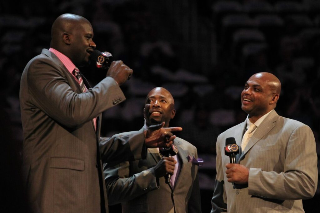 February 24, 2012; Orlando FL, USA; TNT anchor Kenny Smith introduces Team Shaq general manager Shaquille O'Neal and Team Chuck general manager Charles Barkley before the BBVA rising stars challenge at the Amway Center in Orlando. Mandatory Credit: Kim Klement-USA TODAY Sports