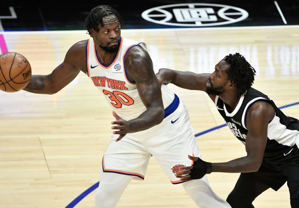May 9, 2021; Los Angeles, California, USA; New York Knicks forward Julius Randle (30) looks to pass the ball to defended by LA Clippers guard Patrick Beverly during the second quarter at Staples Center. Mandatory Credit: Robert Hanashiro-USA TODAY Sports