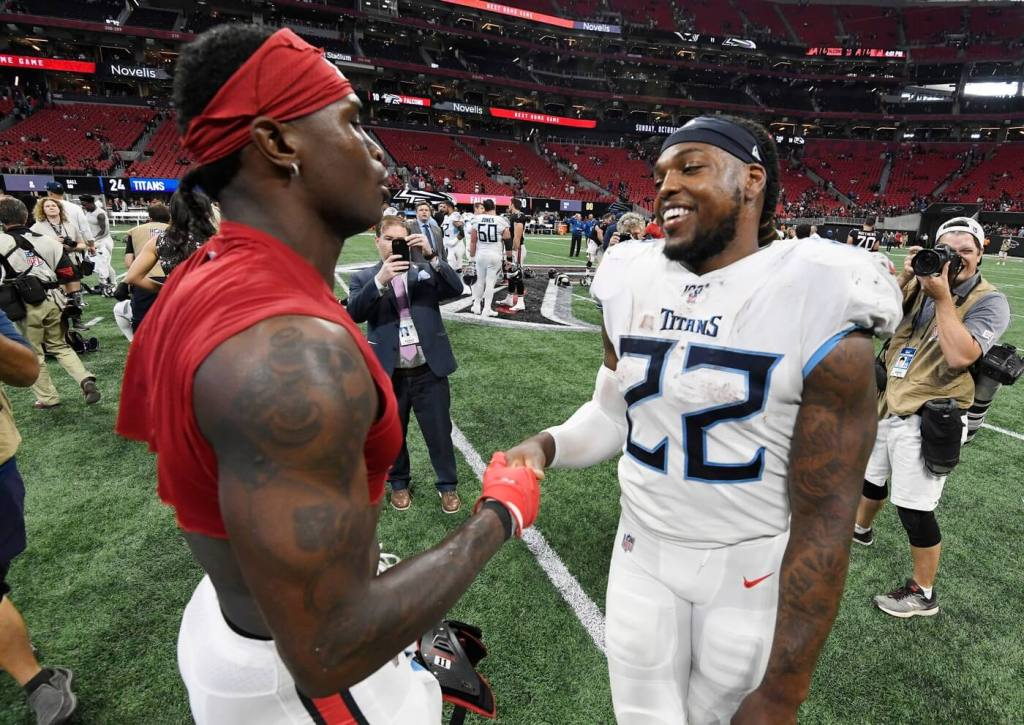 Atlanta Falcons wide receiver Julio Jones (11) and Tennessee Titans running back Derrick Henry (22) greet each other after the Titans' 24-10 win at Mercedes-Benz Stadium Sunday, Sept. 29, 2019 in Atlanta, Ga. 8508847