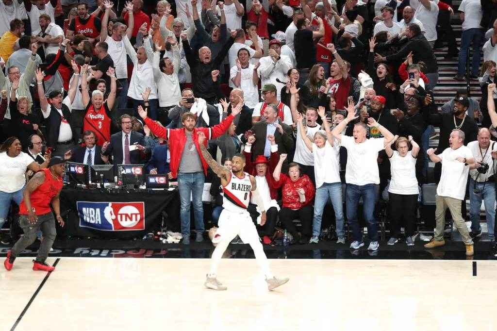 Apr 23, 2019; Portland, OR, USA; Portland Trail Blazers guard Damian Lillard (0) reacts after making a three-point shot over Oklahoma City Thunder forward Paul George (13) to defeat Oklahoma City Thunder 118-115 in game five of the first round