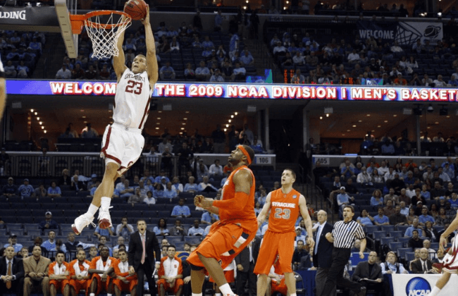 Mar 27, 2009; Memphis, TN, USA; Oklahoma Sooners forward Blake Griffin (23) shoots as Syracuse Orange forward Arinze Onuaku (21) and Eric Devendorf (23) defend in the Sooners 84-71 victory against the Orange in the semifinals of the south region of the 2009 NCAA basketball tournament at the FedEx Forum. Mandatory Credit: Bob Donnan-USA TODAY Sports