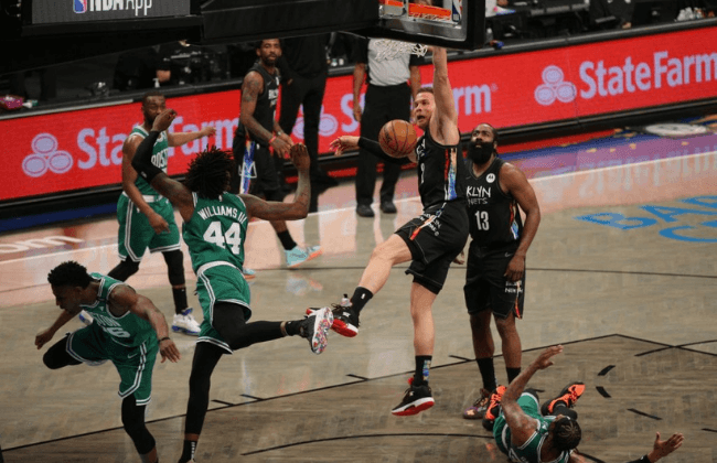 May 25, 2021; Brooklyn, New York, USA; Brooklyn Nets power forward Blake Griffin (2) dunks against Boston Celtics center Robert Williams III (44) during the third quarter of game two of the first round of the 2021 NBA Playoffs at Barclays Center. Mandatory Credit: Brad Penner-USA TODAY Sports