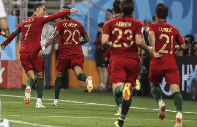 Jun 25, 2018; Saransk, Russia; Portugal player Ricardo Quaresma (20) is congratulated by teammate Cristiano Ronaldo after scoring a goal against Iran in Group B play during the FIFA World Cup 2018 at Mordovia Arena. Mandatory Credit: Leonel de Castro/Global Images/Sipa USA via USA TODAY Sports