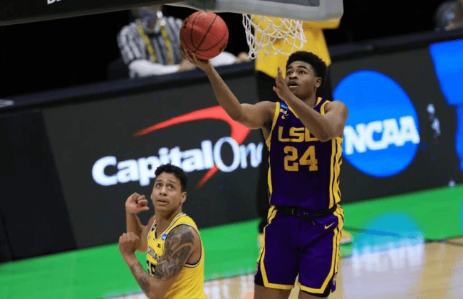 Louisiana State Tigers guard Cameron Thomas (24) goes up for a shot during the first half in the second round of the 2021 NCAA Tournament against the Michigan Wolverines at Lucas Oil Stadium.