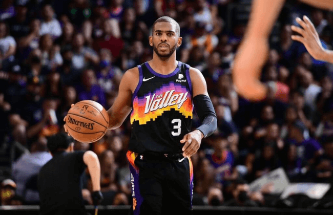 PHOENIX, AZ - JUNE 9: Chris Paul #3 of the Phoenix Suns dribbles the ball against the Denver Nuggets during Round 2, Game 2 of the 2021 NBA Playoffs on June 9, 2021 at Phoenix Suns Arena in Phoenix, Arizona. NOTE TO USER: User expressly acknowledges and agrees that, by downloading and or using this photograph, user is consenting to the terms and conditions of the Getty Images License Agreement. Mandatory Copyright Notice: Copyright 2021 NBAE (Photo by Michael Gonzales/NBAE via Getty Images)