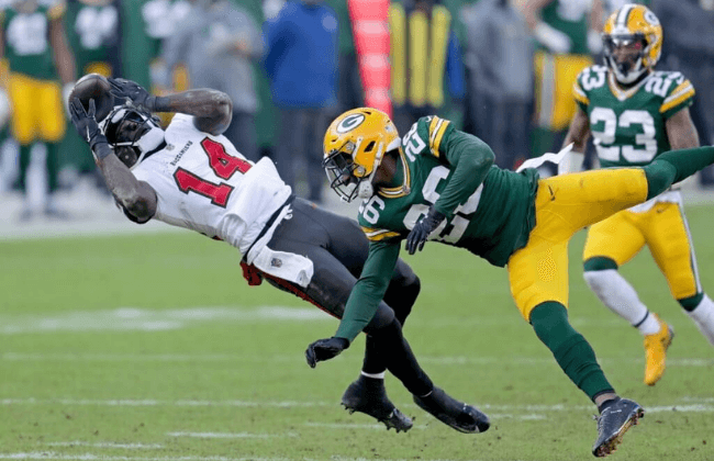 Tampa Bay Buccaneers wide receiver Chris Godwin (14) hauls in a long reception as Green Bay Packers free safety Darnell Savage (26) defends during the 2nd quarter of the Green Bay Packers game against the Tampa Bay Buccaneers in the NFC championship playoff game Sunday, Jan. 24, 2021, at Lambeau Field in Green Bay, Wis. Packers Packers25 Mjd 07431