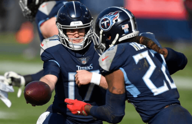 Quarterback Ryan Tannehill (17) hands off to running back Derrick Henry (22)during the Tennessee Titans game against the Baltimore Ravens in Nashville on January 10, 2021. Titans Ravens 099