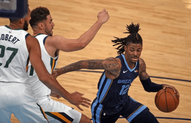 May 31, 2021; Memphis, Tennessee, USA; Memphis Grizzlies guard Ja Morant (12) dribbles during the second quarter during game four in the first round of the 2021 NBA Playoffs against the Utah Jazz at FedExForum. Mandatory Credit: Petre Thomas-USA TODAY Sports