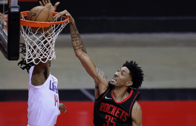 Apr 23, 2021; Houston, Texas, USA; Christian Wood #35 of the Houston Rockets dunks the ball against Terance Mann #14 of the Los Angeles Clippers during the third quarter at Toyota Center. Mandatory Credit: Carmen Mandato/POOL PHOTOS-USA TODAY Sports