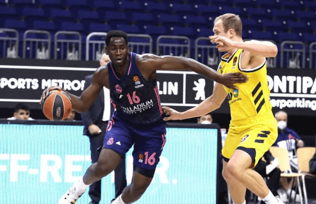 Usman Garuba, #16 of Real Madrid competes with Luke Sikma, #43 of ALBA Berlin during the 2020/2021 Turkish Airlines EuroLeague Regular Season Round 23 match between Alba Berlin and Real Madrid at Mercedes Benz Arena on January 29, 2021 in Berlin, Germany.