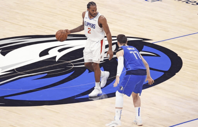 Jun 4, 2021; Dallas, Texas, USA; LA Clippers forward Kawhi Leonard (2) dribbles as Dallas Mavericks guard Luka Doncic (77) defends during the fourth quarter during game six in the first round of the 2021 NBA Playoffs at American Airlines Center. Mandatory Credit: Kevin Jairaj-USA TODAY Sports