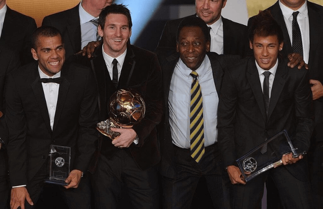 Barcelona's Argentinian forward Lionel Messi (2ndL) poses near Brazilian football legend Pele (C), Barcelona's Brazilian Dani Alves (L) and Santos FC' Brazilian forward Neymar (R) after receiving for the third time the FIFA Ballon d'Or award on January 9, 2012 at the Kongresshaus during the FIFA Ballon d'Or ceremony in Zurich.         AFP PHOTO / FRANCK FIFE (Photo credit should read FRANCK FIFE/AFP via Getty Images)