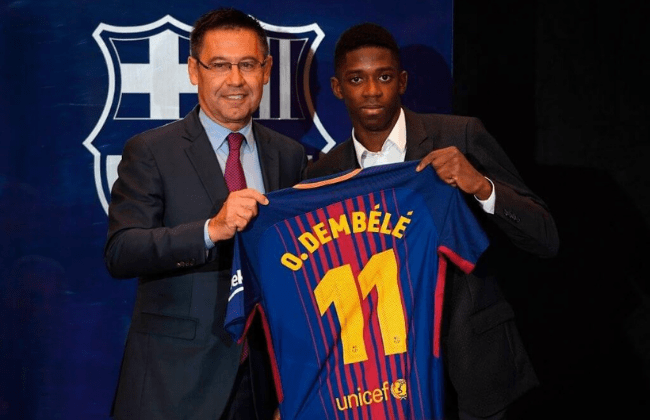 Barcelona's new player Ousmane Dembele (R) poses with his new jersey next to Barcelona's president Josep Maria Bartomeu at the Camp Nou stadium in Barcelona, during his official presentation at the Catalan football club, on August 28, 2017. French starlet Ousmane Dembele agreed a five-year deal with Barcelona worth 105 million euros ($125 million) plus add-ons. Dembele, 20, moves from Borussia Dortmund, where he has been suspended since he boycotted training on August 10 in protest after the German club rejected Barca's first bid. / AFP PHOTO / LLUIS GENE (Photo credit should read LLUIS GENE/AFP via Getty Images)