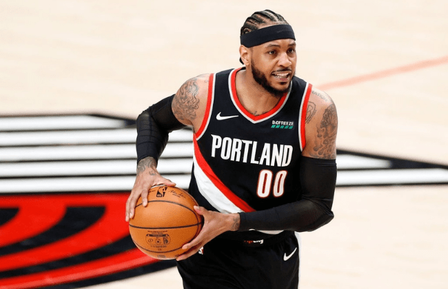 PORTLAND, OREGON - MAY 29: Carmelo Anthony #00 of the Portland Trail Blazers looks to pass in the first quarter against the Denver Nuggets during Round 1, Game 4 of the 2021 NBA Playoffs at Moda Center on May 29, 2021 in Portland, Oregon. NOTE TO USER: User expressly acknowledges and agrees that, by downloading and or using this photograph, User is consenting to the terms and conditions of the Getty Images License Agreement. (Photo by Steph Chambers/Getty Images)