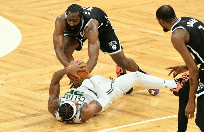 May 30, 2021; Boston, Massachusetts, USA; Boston Celtics guard Marcus Smart (36) and Brooklyn Nets guard James Harden (13) reach for the ball during the second half of game four in the first round of the 2021 NBA Playoffs. at TD Garden. Mandatory Credit: Brian Fluharty-USA TODAY Sports