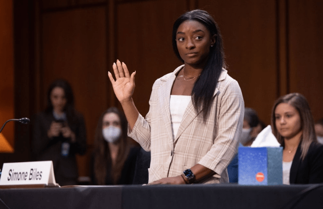 WASHINGTON, DC - SEPTEMBER 15: U.S. Olympic gymnast Simone Biles is sworn in to testify during a Senate Judiciary hearing about the Inspector General's report on the FBI handling of the Larry Nassar investigation of sexual abuse of U.S. gymnasts, on Capitol Hill, September 15, 2021, in Washington, DC. (Photo by Saul Loeb - Pool/Getty Images)