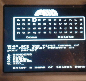 """A photograph of a handheld Oregon Trail game. The screen asks players to input party member names. Party members include: Sanders, Alex, Rachel, Maurice, and Zed. Yes, """"Zed"""" is a reference to Zardoz, which we had watched the night before. The Oregon Trail, MECC, Brøderbund, 1971."""
