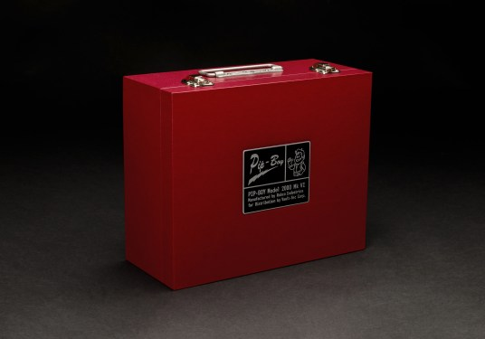 The Pip-Boy 2000 case. Image from THINKGEEK.com https://www.thinkgeek.com/product/ktgg/