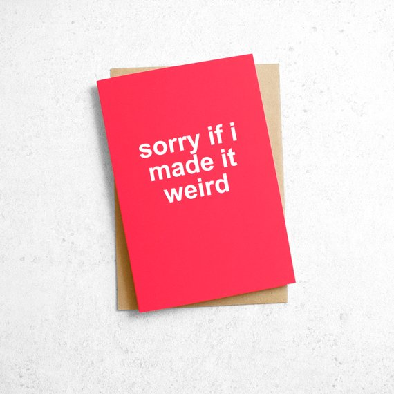 """An image of a pink card reading, """"sorry if i made it weird"""" in white letters."""