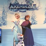 A mural poster of the snowy world of Arendelle in Kingdom Hearts 3, with Anna and Elsa standing together on a frozen lake while Olaf the snowman frolicks at their feet. The word Arendelle in sparkly blue letters floats above the sisters. Kingdom Hearts Pop-Up, Disney Springs, 2018