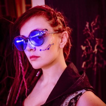 Promo photo for Cyberpunk Night City of woman in cyberpunk costume (photo used with permission by Jackalope LARP)